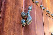 picture of hasp  - A broze hasp in an antique wooden door in Cartagena - JPG