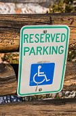 picture of handicap  - Reserved parking sign for handicapped people denoted by the wheelchair on the sign - JPG