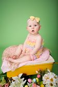 pic of baby easter  - Baby girl in Easter outfit with Easter Eggs and tulip flowers sitting on blanket - JPG