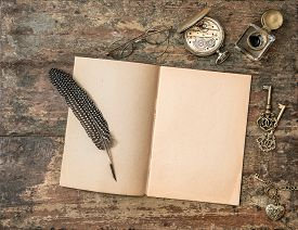 picture of inkwells  - Open book and vintage writing accessories - JPG