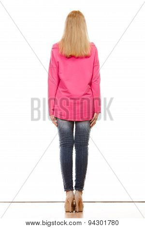 Woman In Denim Pants Pink Blouse Back View