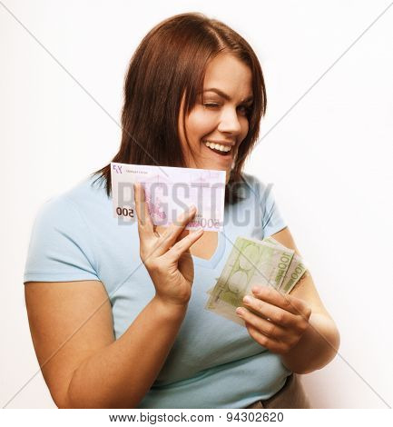 portrait of real fat young woman with money isolated