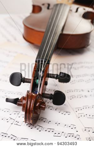 Classical violin on music sheets background