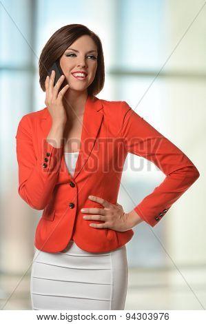 Portrait of businesswoman using cellphone inside office building