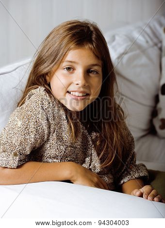 little cute brunette girl at home smiling close up