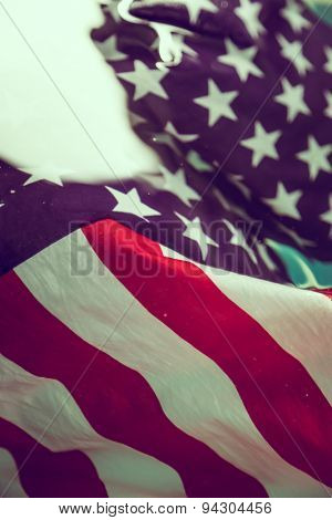 American flag in water ( Filtered image processed vintage effect. )