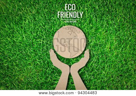 Paper cut of  eco friendly earth on green grass