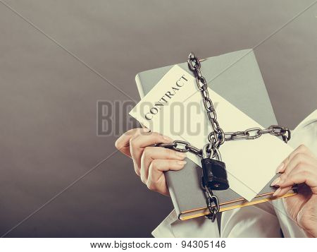 Woman Holding In Hands Contract And Chain With Padlock