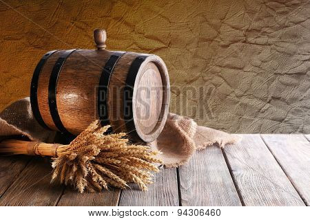 Old barrel with wheat on table