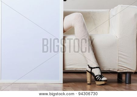 Woman Legs With Blank Presentation Board.