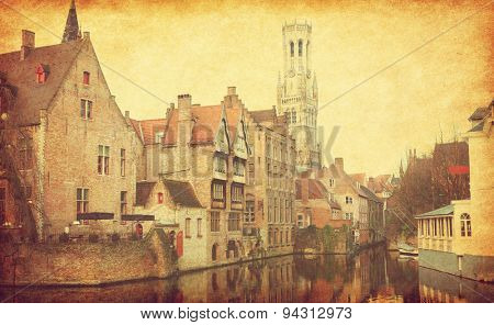 Bruges historic centre, Belgium.  Photo in retro style. Added paper texture