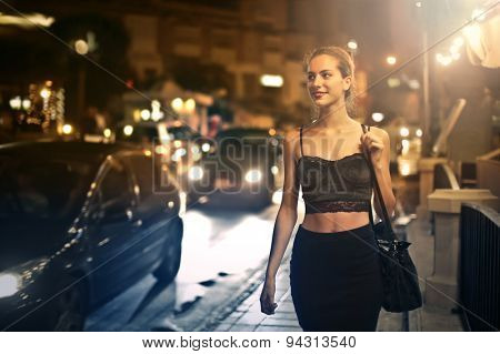 Girl walking in the night