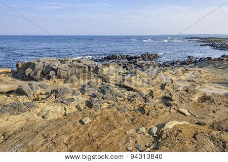 Coast Of Jeju Island With Volcanic Rocks