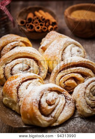 Homemade cinnamon rolls on wooden table