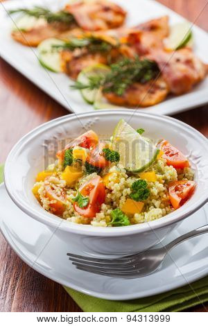 Fresh couscous salad for summer with tomato, pepper with olives