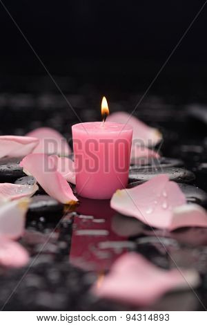 Still life with rose petals, candle and wet stones