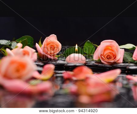 Beautiful orange rose ,petals with candle and therapy stones