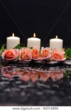 Beautiful orange rose with three candle and therapy stones