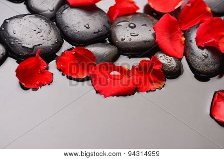 Red rose petals and therapy stones