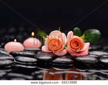 Beautiful orange rose with two candle and therapy stones