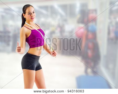Young sporty girl at fitness club