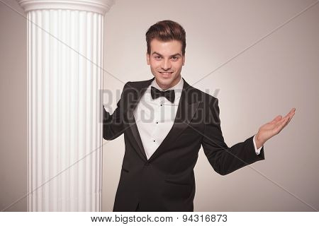 Handsome elegant business man smiling and welcoming you with his arms open.