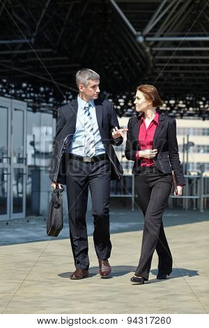 business man and woman outdoor