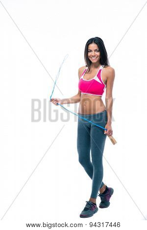 Full length portrait of a smiling sports woman holding skipping rope isolated on a white background