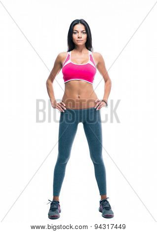 Full length portrait of a fitness woman standing isolated on a white background