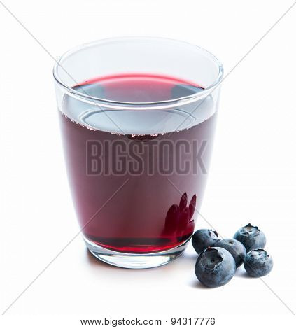 Glass of fresh blueberry juice with fresh blueberries on white