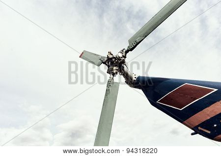 the tail rotor of the helicopter against the sky