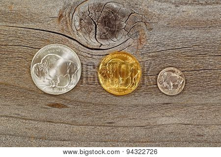 American Buffalo Coins On Rustic Wooden Background