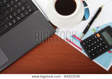 Laptop, Calculator, Cup Of Coffee And Crumpled Paper