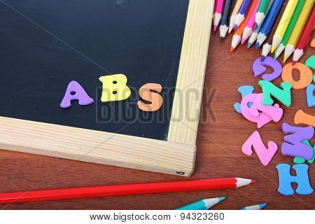 Chalk Board, Letters And Pencils