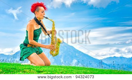 Young Saxophonist (woman With The Red Hair) Playing Saxophone In The Mountain Nature.