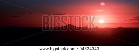 Sunset silhouette over the mountain