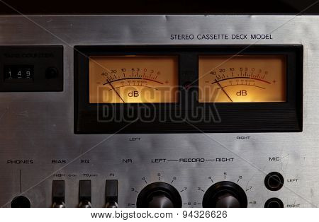 Vintage stereo cassette tape deck player recorder VU meters closeup