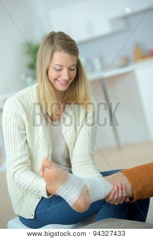 Bandaging her friend's leg