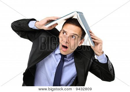 Scared Young Man Covering His Head With A Book