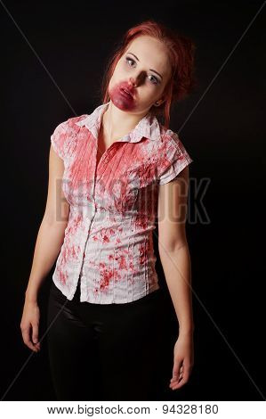 female zombie with bloody mouth and blouse