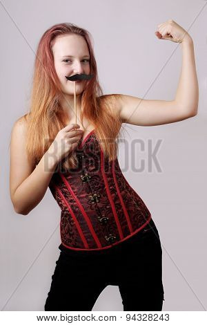 young woman with fake moustache