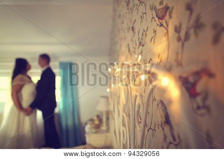 Lights On Wall With Bride And Groom As Silhouettes