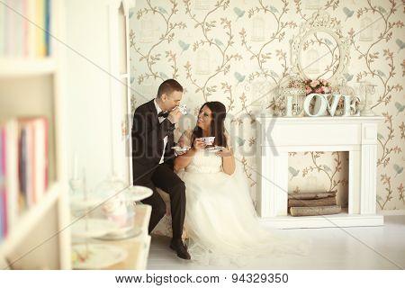 Bride And Groom Drinking Tea