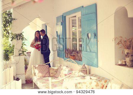 Bride And Groom Near Beautiful Vintage House