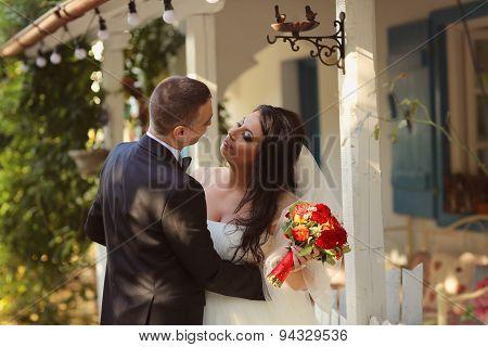 Bride And Groom Near Beautiful House