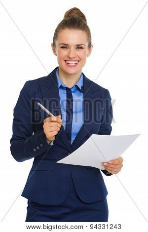 Smiling Businesswoman Holding Paper And Pen