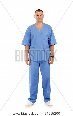 Full Length Portrait Of A Young Male Doctor In A Medical Surgical Blue Uniform