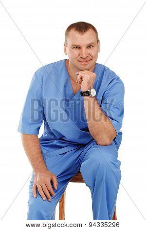 Portrait Of A Young Male Doctor In A Medical Surgical Blue Uniform