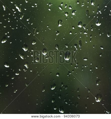 Water and rain drops on the glass, abstract view, Drops of rain on blue glass background drops