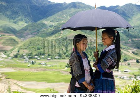 Two girls of the H'mong Ethnic Minority People near terraced rice field